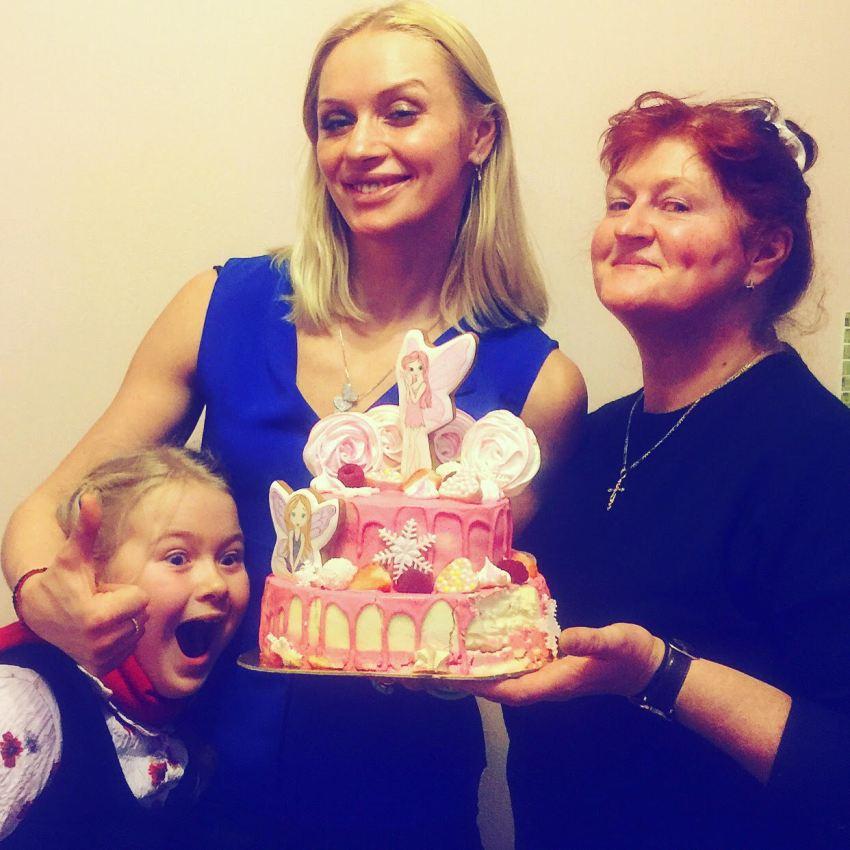 Svetlana Kulakova with her family