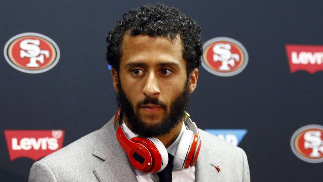 Colin Kaepernick takes a stand not to stand