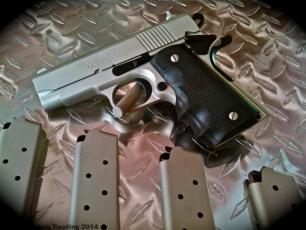 Compact 1911 in Cerakote Shimmer Gold & Graphite Black