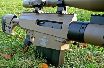 Laser etched Bushmaster logo over Cerakote Magpul FDE