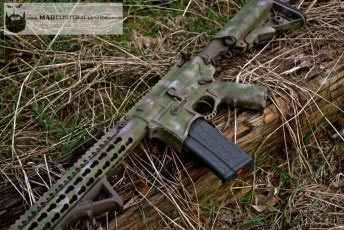 Seekins Precision AR in Cerakote A-Tacs camo using Patriot Brown, Desert Sand, Magpul FDE & custom mix green