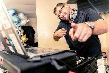 Dj Krazee D working the equipment