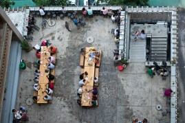 Neighbourgoods Market tables and patrons from a toilet window