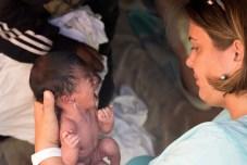 Tanja examining the baby