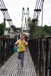 """Look at me run, mom (and dude with that camera)."" Kalo Pool Suspension Bridge, Teku"