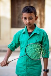 Aspiring champion Badminton player in the streets of Patan.