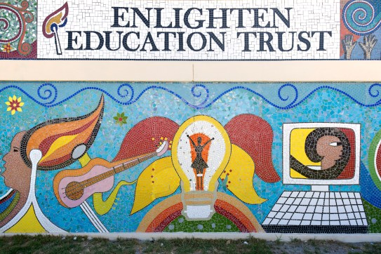 The mosaic wall outside Enlighten's centre.