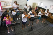 The brand new Enlighten violin group, with 12 members from across the community.