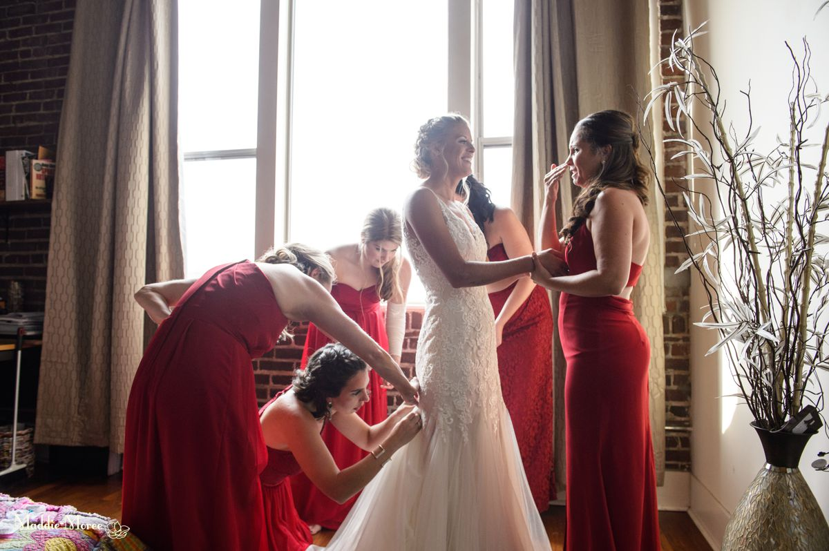 Bridesmaids helping with dress