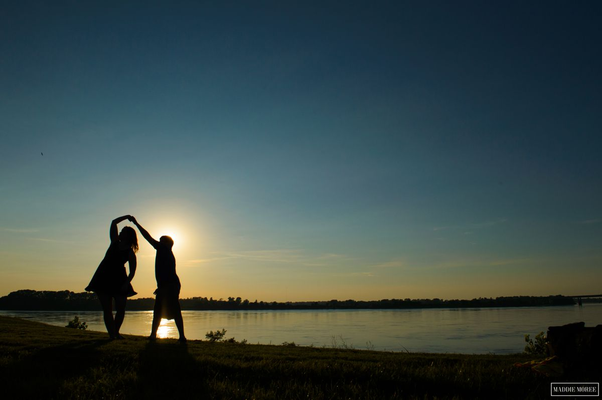 sunset engagement on the river