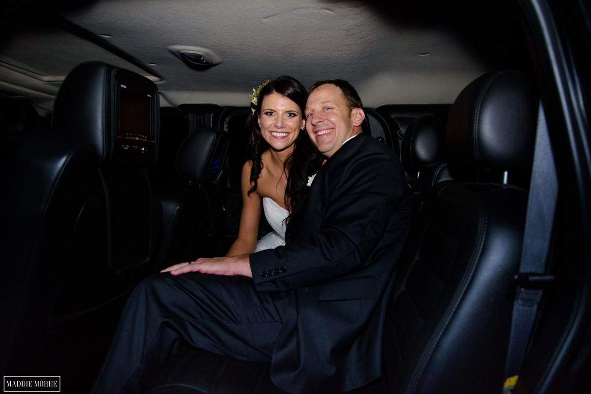 bride and groom getaway car