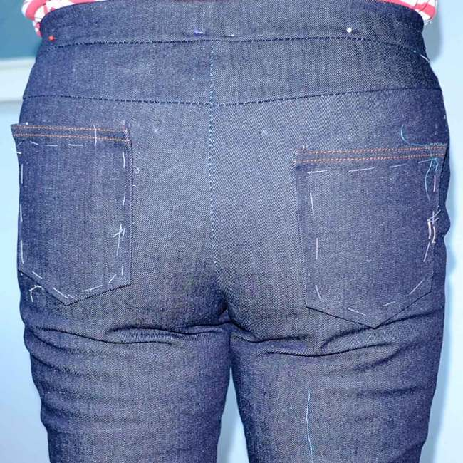Jeans pockets tacked in place to check placement