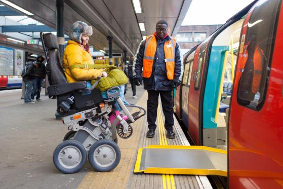 Customer uses ramp to board a London Underground Train