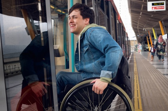 Wheelchair user boarding a DLR train