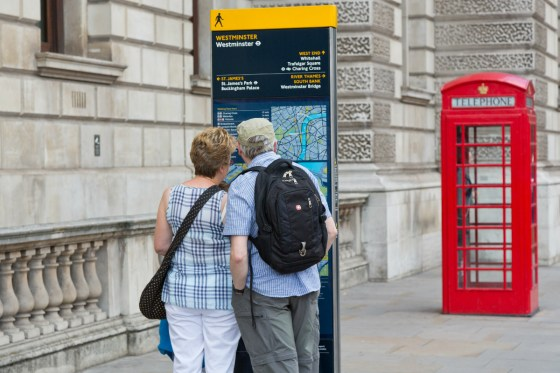 Couple checking a Legible London map
