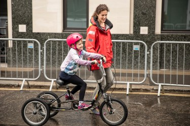 Child cycling with adult