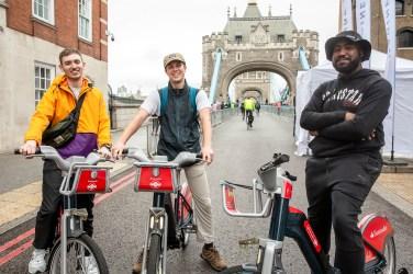People posing on Santander Cycles bikes