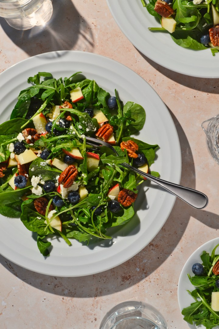 Blueberry Apple Pecan Salad on a white plate.