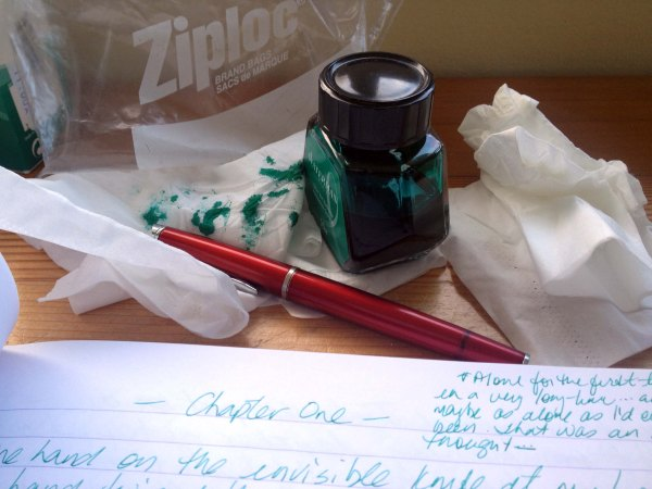 green inked tissues and pen