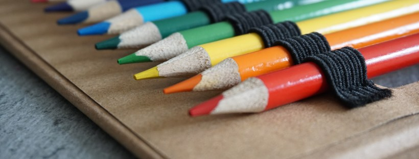 close up of a rainbow of colouring pencils