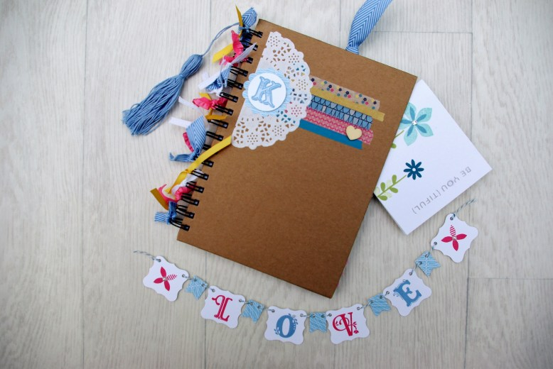 Decorated notebook and mini bunting as party of the Stationery Crazy party by Made By Me Craft Parties.
