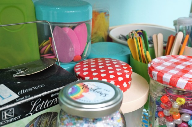 Jars and tubs of children's craft supplies