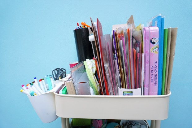 An art cart full of children's craft supplies