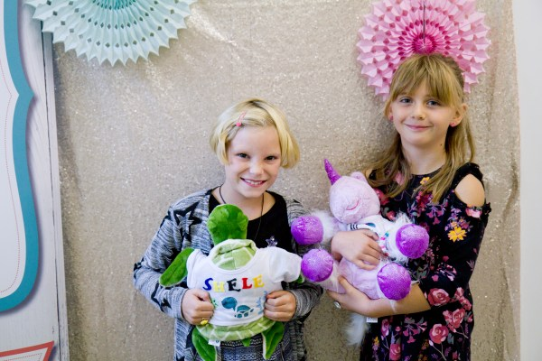 2 girls posing with their teddies at a Made By me Craft Party
