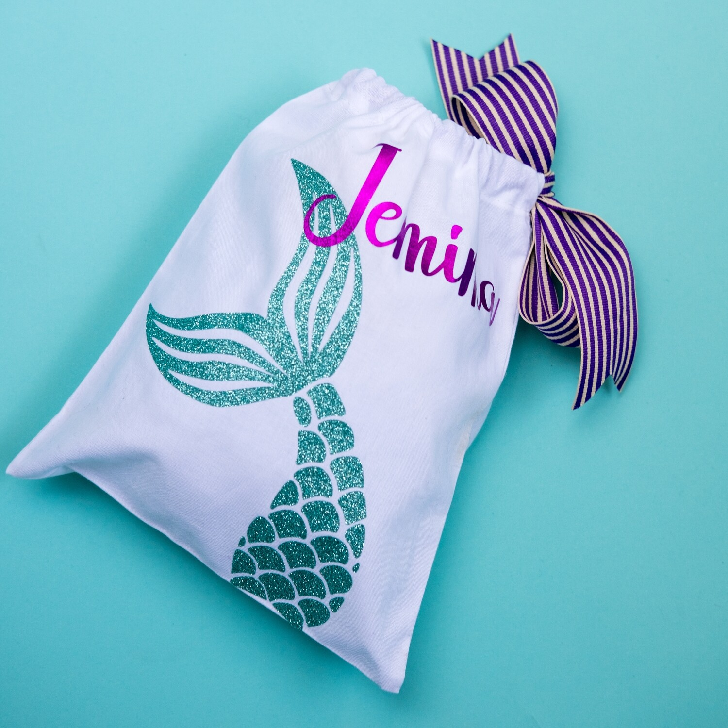 Fabric party bag with mermaid tail on it