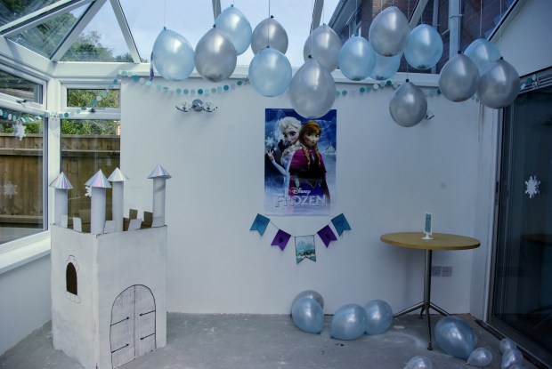Frozen party decorations, blue balloons, cardboard castle and bunting