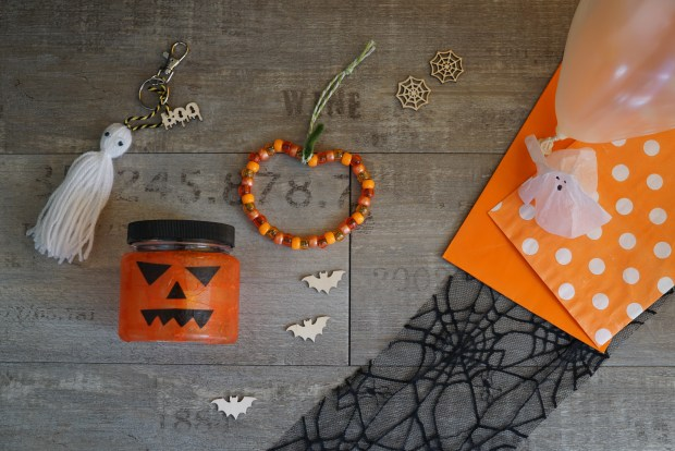 Halloween craft kit showing ghost tassel, pumpkin lantern, pumpkin decoration