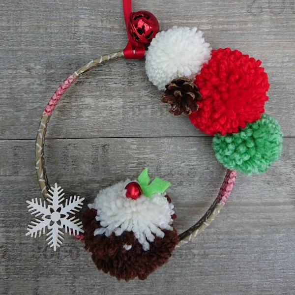 Christmas wreath with pom poms and Christmas pudding pom pom