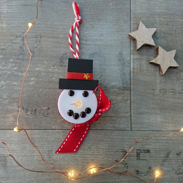 Snowman decoration made out of a led tealight as part of a childrens craft kit