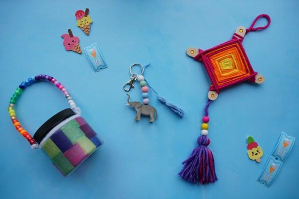 summer staycation craft kit showing an elephant keyring, eye of god and lantern