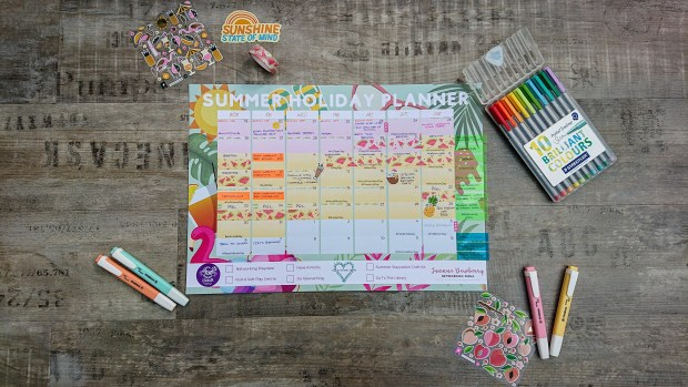 Easy summer crafts for kids.  summer holiday planner surrounded by pens and stickers