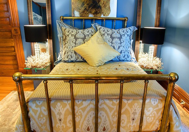 Chic ikat bedding in Bedroom Eclectic with Picture Over Bed next to Brass Bed alongside Wrought Iron Bed Ideas and Cool Bed