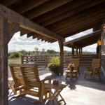 Sumptuous porch glider in Patio Rustic with Roof Extension Cover next to Support Beams alongside Split Rail Fence and Ranch Porch