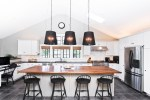 Amazing Wet Bar Pictures Home Bar Traditional with Natural Materials Lake Geneva Great Room Outdoor Entertaining Lowell Custom Homes Elephants On The Wall Herringbone Built-in Storage indoor-outdoor