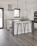 Laminate Flooring Images with Island Shelf Granite Counter Distressed Cabinets