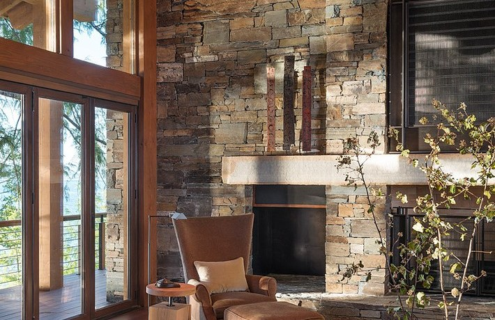 seattle natural stone fireplace surround with storage ottomans family room rustic and wood door trim brown armchair