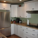 shepherd montana united states sage green home with kitchen craftsman and wood wall trim white cabinets