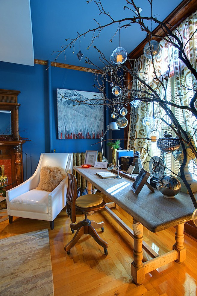 calgary current decorating color with orange wall unit bookcases home office eclectic and ornaments blue walls