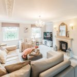 cambridgeshire shabby chic living with furniture and accessory companies room shabby-chic style gold white wallpaper wall lights