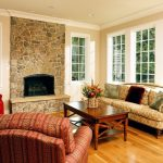 DC Metro camelback sofa slipcover Living Room Traditional with window treatment professionals stone fireplace