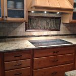 Awesome wood vent hood in with quartz countertops14 and gray green kitchen
