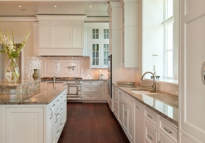 Brilliant white glass subway tile backsplash Tropical Kitchen in Miami with flowers and high ceiling