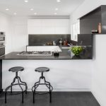 Dishy kitchen paneling Contemporary Kitchen in Los Angeles with black countertop and tile floors