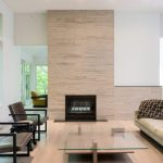 Brilliant metal and glass etagere Scandinavian Living Room in Minneapolis with limestone tile surround leather chair