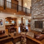 Delightful fireplace stacked stone Traditional Living Room in Sacramento with metal door and double sided