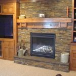 Fabulous fireplace stacked stone Traditional Family Room in Minneapolis with slate and